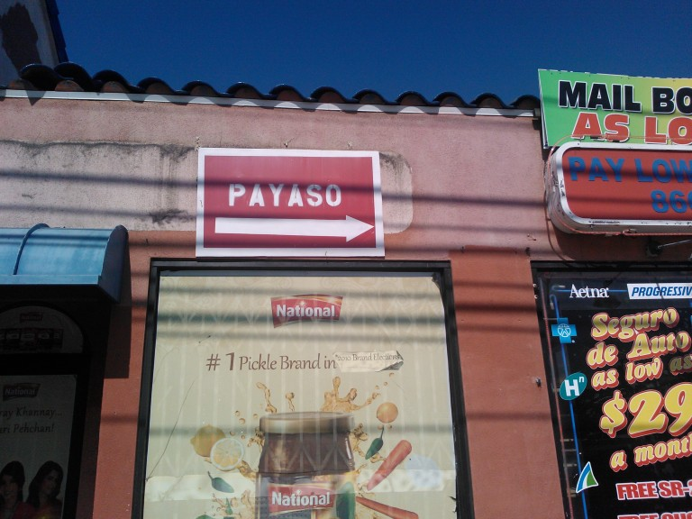 """Truthfully it's a sign pointing to The """"Payaso Party Supply Store."""" But out of context, it's just hilarious!"""